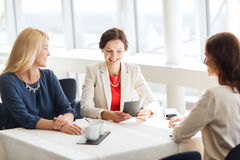 Happy women looking at restaurant bill Royalty Free Stock Photography
