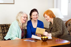 Happy Women Looking at their Old Photo in an Album Royalty Free Stock Image
