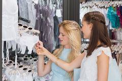 Happy women looking at underwear Stock Photos