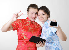Happy women with mobile devices Royalty Free Stock Images