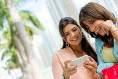 Happy women with a mobile phone Royalty Free Stock Photos