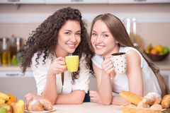 Happy women with the morning cups of tea Stock Photos