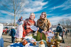 Happy women in national clothes celebrating Shrovetide at Belarus royalty free stock image