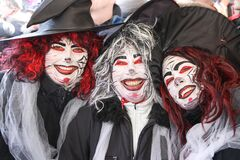3 happy women with painted faces