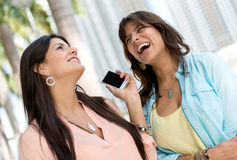 Happy women on the phone Stock Photography
