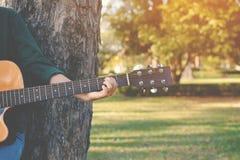 Happy women playing guitar Stock Image