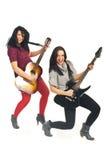 Happy women playing guitars Stock Photography