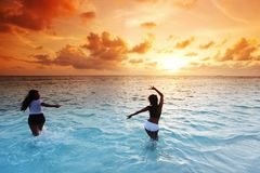 Happy women playing in water Royalty Free Stock Photos