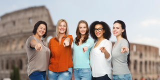 Happy women pointing finger on you over coliseum Royalty Free Stock Photography