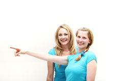 Happy women pointing off frame Royalty Free Stock Image