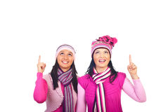 Happy women pointing up to white space royalty free stock images