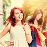 Happy women with purchases Stock Image