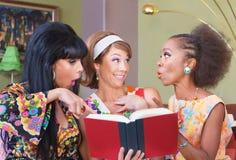 Happy Women Reading Stock Images