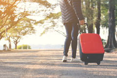 Happy women with red luggage Royalty Free Stock Image