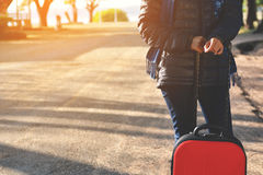 Happy women with red luggage Royalty Free Stock Photo