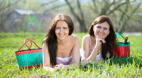 Happy women relaxing in   park Stock Images