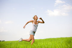 Happy women runing in field Stock Photo
