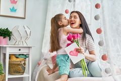 Daughter is congratulating mom Royalty Free Stock Image