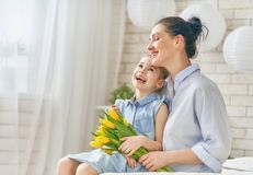 Daughter congratulating mom Stock Photo