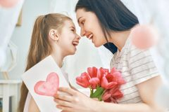 Daughter is congratulating mom Royalty Free Stock Photos