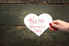 Happy women`s day. Female hand holding card with inscription Happy women`s day Stock Photography