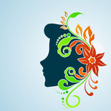 Happy Women's Day greeting card or background. With a blue silhouette of a women with floral decorative hairs stock illustration