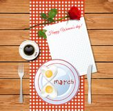 Happy women`s day greeting card with number 8 shaped fried eggs. Happy women`s day greeting card with number 8 shaped fried heart eggs on plate and cup of coffee Stock Photos