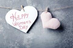 Happy women`s day. Inscription Happy women`s day on paper heart Royalty Free Stock Photo
