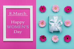 Happy Women`s Day Pastel Candy Colours Background. Floral womens day flat lay with beautifully wrapped present. Happy Women`s Day Pastel Candy Colours royalty free stock photos