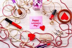 Happy Women`s Day pink card. Jewelry items and cosmetics. Complete your style. Chic in every detail royalty free stock photography