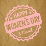 Happy Women`s Day rubber stamp baby pink on a crumpled paper brown background. royalty free illustration
