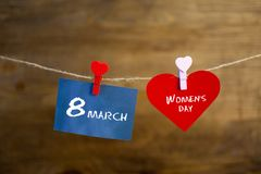Happy Women`s Day text written with chalk on the stickers and red heart Stock Photography