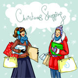 Happy women with shopping bags Stock Images