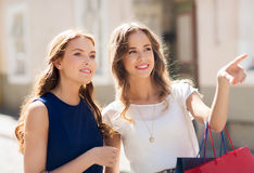 Happy women with shopping bags in city Royalty Free Stock Image