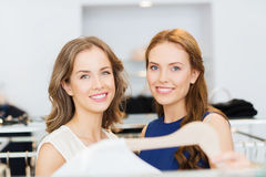Happy women with shopping bags at clothing shop Royalty Free Stock Photography