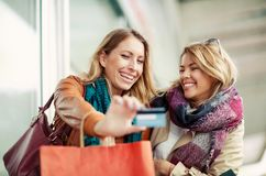 Woman with shopping bags holding credit card Stock Photo