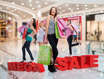 Happy women with shopping bags at store Royalty Free Stock Photos