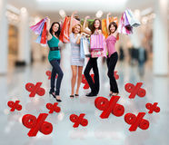 Happy women with shopping bags at store Stock Image