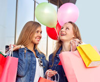 Happy women shopping and holding bags Royalty Free Stock Photography