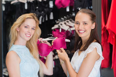 Happy women showing a bra Stock Image