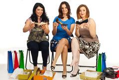 Happy women showing new shoes Royalty Free Stock Photo