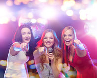 Happy women singing karaoke and dancing Royalty Free Stock Photography