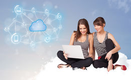Happy women sitting on clous with cloud computing Stock Image