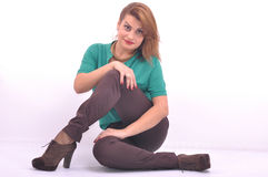 Happy women is sitting and smiling Royalty Free Stock Images