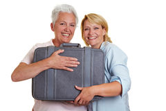 Happy women with suitcase Royalty Free Stock Photos