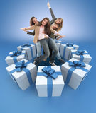 Happy women surrounded by gifts blue Stock Image
