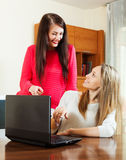 Happy women  at table with laptop Stock Photography