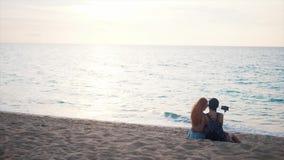 Happy women taking selfie photo on the beach. Happy women enjoying vacation taking selfie photo stock footage