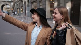 Happy women taking selfie after shopping on phone stock footage
