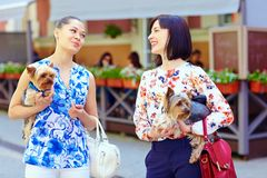 Happy women talking on crowded city street Royalty Free Stock Images